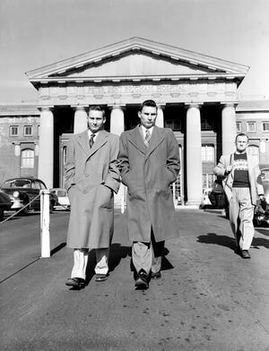 Richard Herrick, left, and his twin brother, Ronald, leave Peter Bent Brigham Hospital in Boston, on Jan. 30, 1955, after fully recovering from a kidney transplant, Dec. 23, a first between identical twins. Ronald donated one of his kidneys to his 23-year-old brother Richard, who suffered from uremic poisoning because of chronic kidney failure. Richard now has three kidneys, and surgery may later remove his original two.