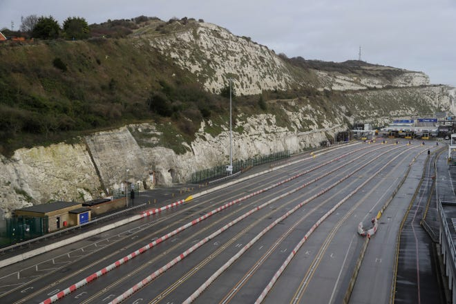 The ferry terminal check-in is seen empty alongside the White Cliffs of Dover, whilst the Port remains closed, Tuesday in Dover, England.