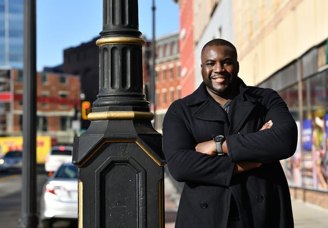 Adrian M. Mompoint, stands 6-foot-5, and has been Big Papi's stand-in on three projects. The Worcester resident is featured in a Downy detergent commercial that has him as an assistant locker room manager for the New England Patriots. Cam Newton makes a cameo at the end of the spot.