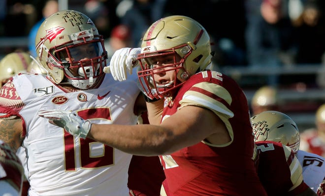 Boston College offensive lineman Alec Lindstrom, right, a former Shepherd Hill star, was named to the All-ACC First Team on Tuesday.