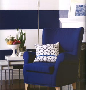 These bold stripes provide a youthful and adventurous background for an upbeat living space.