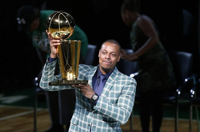 Paul Pierce holds up the 2008 NBA championship trophy during the Celtics' ceremony retiring his No. 34 at TD Garden.