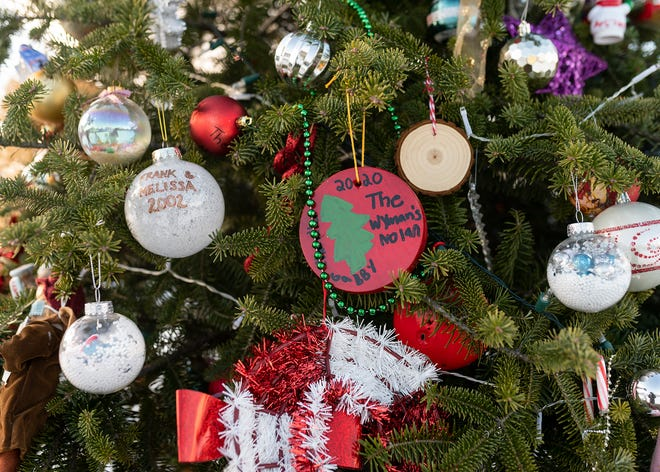 Residents in the Burncoat section of Worcester recently adopted a neighborhood holiday wishing tree, which families have decorated with personal ornaments.