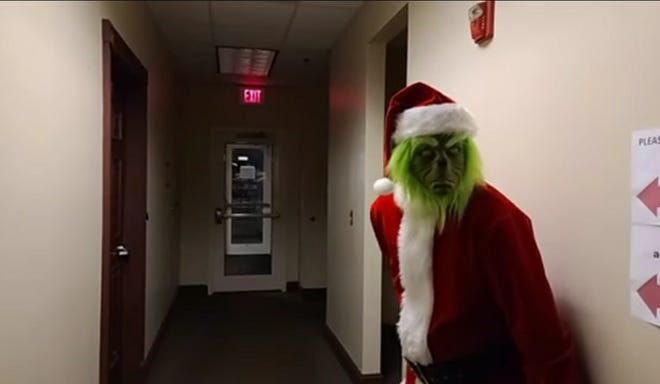 The Grinch sneaks into Lumberton City Hall. He was later nabbed by the Robeson County Sheriff's Office for stealing gifts, intruding on a good Christmas carol and for just in general being 'a mean one.'