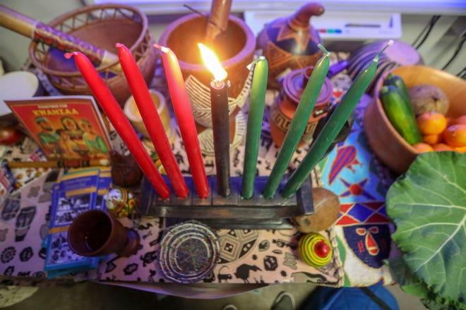 A Kinara holds seven candles representing the seven principles of Kwanzaa: Umoja (unity), Kujichagulia (self-determination), Ujima (collective work and responsibility), Ujamaa (cooperative economics), Nia (purpose), Kuumba (creativity) and Imani (faith).