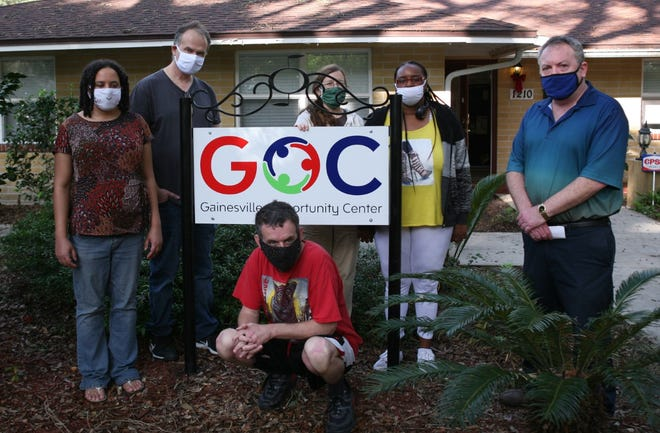 In front of the Gainesville Opportunity Center are front from left;  John Smith (crouching) and Brett Buell, co-director of GOC. In the back are from left Susan Thomas, Mark Bielawa, Sandy Munson, and Terrica Nelson-Gent. [Special to The Guardian]