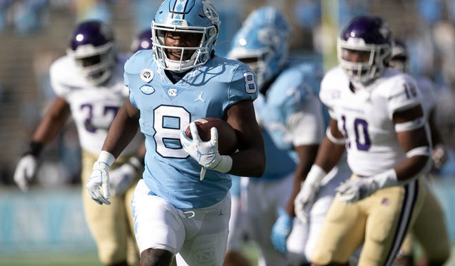 North Carolina running back Michael Carter races in for a touchdown during a victory against Western Carolina earlier this month.