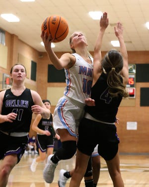 Southside's Ashlyn Roffine takes the shot in the paint over Mount St. Mary's Alexia Coca in the fourth quarter, Monday, Dec. 21, at Chaffin Jr. High.