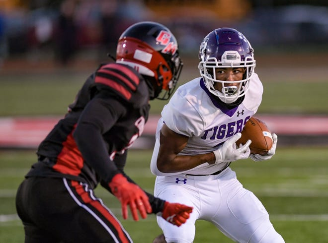 Pickerington Central's Lorenzo Styles Jr. looks to elude Groveport's John Motton during the Tigers' 43-3 win Sept. 18. Styles has signed with Notre Dame and Motton has signed with Ohio University.