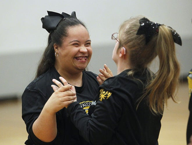 Franklin Heights High School cheerleaders Karyna Redman and Skylar Murdock share a laugh after their cheer routine during the South-Western Special Olympics basketball-drills event at Central Crossing on Feb. 19.