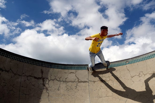 Osten McDaniel of Powell skateboards around the edge of Adventure Park's skate pool in Powell on June 23. While skaters can find summertime solace at the park, the nearby swimming pool – and the splash pad at Village Green Park – remained closed due to the COVID-19 coronavirus pandemic.
