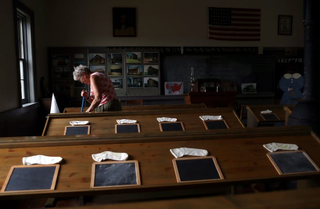 Joan Eyerman, Century Village chairman, cleans the floors inside the Orders Road schoolhouse in Grove City on July 22. Century Village was forced to close because of the COVID-19 coronavirus pandemic, but members continued upkeep on the attraction in hopes to reopen.