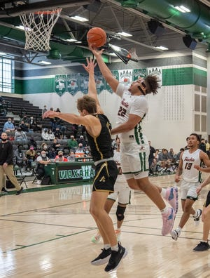 Waxahachie's CJ Noland (22) goes strong to the rack during Saturday's non-district game against Amarillo at Mike Turner Gymnasium. The Class 6A No. 4-ranked Runnin' Indians beat the 5A No. 7 Sandies, 52-43.