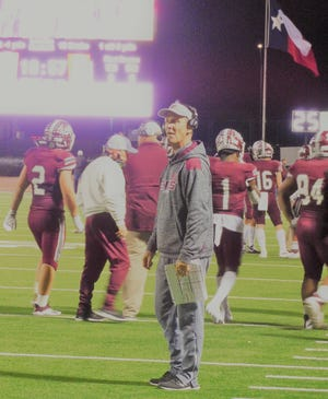 Ennis head football coach Sam Harrell looks on in disbelief during the fourth quarter of Friday night's Class 5A Division II area-round game against Mansfield Timberview in Midlothian. The No. 1-ranked Lions' season came to a sudden end in a 42-28 loss.