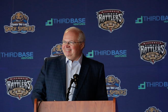 Craig Dickman of Third Base Ventures talks about the purchase of the Wisconsin Timber Rattlers and Fond du Lac Dock Spiders from Appleton Baseball Club, Inc., during a news conference at Neuroscience Group Field at Fox Cities Stadium in Grand Chute.