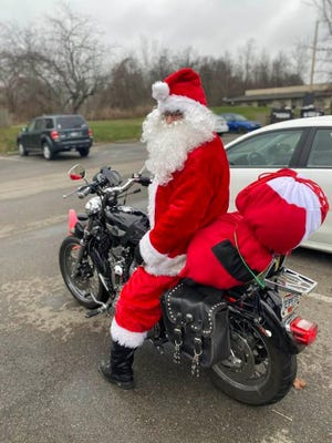 Beginning at 10 a.m. every day, Terry Copeland dresses as Santa Claus, hops on his Harley Davidson and cruises around Chillicothe in the hopes of spreading Christmas Cheer.
