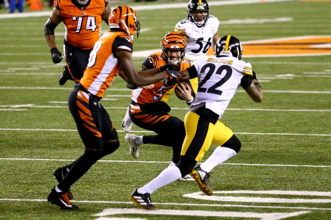 Cincinnati Bengals quarterback Ryan Finley (5) carries the ball in the first quarter during an NFL Week 15 football game against the Pittsburgh Steelers, Monday, Dec. 21, 2020, at Paul Brown Stadium in Cincinnati.