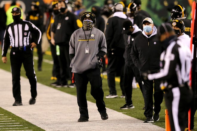 Pittsburgh Steelers head coach Mike Tomlin paces the sideline in the fourth quarter during an NFL Week 15 football game against the Cincinnati Bengals, Monday, Dec. 21, 2020, at Paul Brown Stadium in Cincinnati. The Cincinnati Bengals won, 27-17.