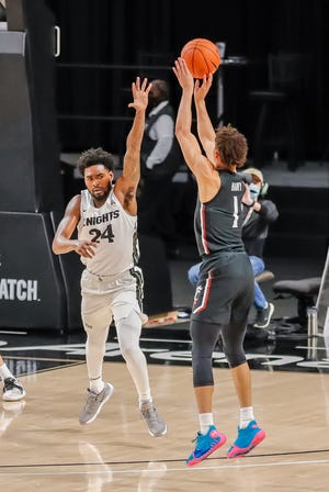 Sophomore guard Zach Harvey, shown playing against UCF,  finished the Bearcats' 82-78 loss at Wichita State with a career-high 19 points on Sunday.