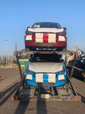 All-electric 2021 Ford Mustang Mach-E  SUVs are seen loaded up on car haulers on December 19, 2020 after being assembled at the Ford plant in Cuautitlán, Izcalli, Mexico.
