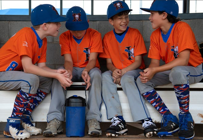 Hoosier Hitmen, from left, Jayden Neidlinger, Aiden Wahl, Jake Kieffner and Liam Morris wait out a rain delay at Deaconess Sports Park Sunday morning, June 14, 2020. Local officials are hoping events such as baseball and softball tournaments will help bolster the hard-hit tourism industry.
