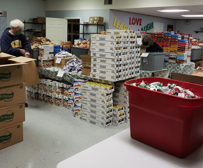 Staff and volunteers prepare 500 bags of food to be distributed through the Ottawa County Family Advocacy Center.