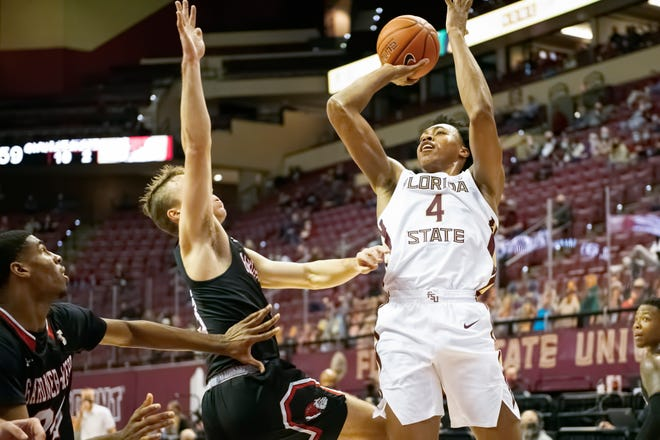Freshman guard Scottie Barnes (4) attempts a jump shot in the second half of Florida State's 72-59 win over Gardner-Webb at the Donald L. Tucker Civic Center in Tallahassee, FL., Dec. 21, 2020.