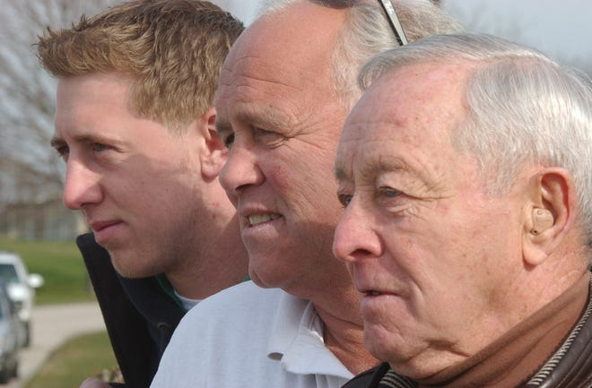 Left to right: Liam Coen, 20, quarterback at the University of Massachusetts, his dad, Tim Coen, football coach at Portsmouth High School, and his grandfather, Phil Coen, who played college football at Boston College, meet at Portsmouth High School for a family photo.