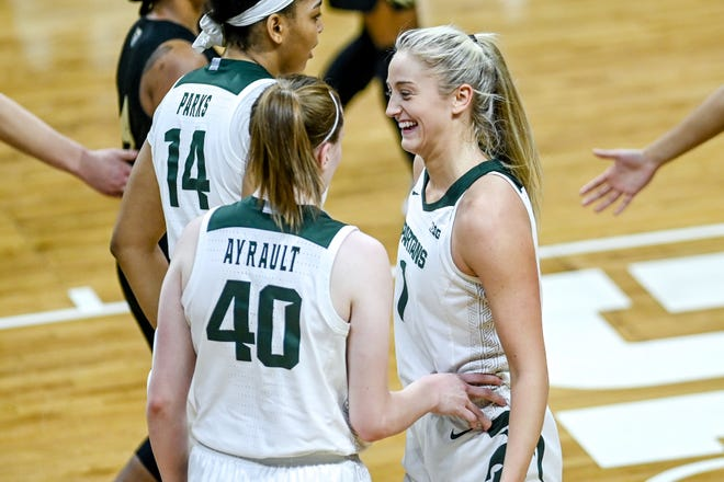Michigan State's Tory Ozment, right, celebrates after Julia Ayrault, left, is fouled on a shot against Oakland during the second quarter on Tuesday, Dec. 22, 2020, at the Breslin Center in East Lansing.