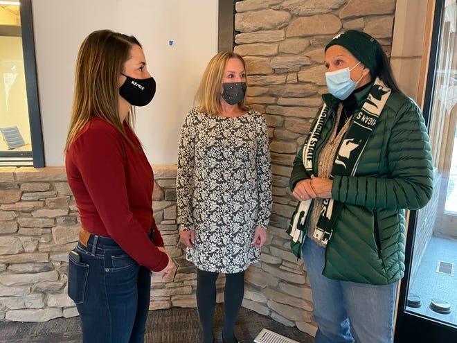 Diane Dalton, right, helps homeless families and at-risk during hard times to pull them up out of trouble and into jobs. Friend Mary Mardigian, center, accompanied Dalton on Dec. 18, 2020 in Okemos to receive an award.