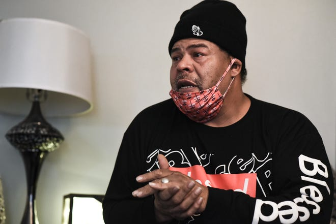 Ronnie Gray talks about the impact gun violence has had on his family, Friday, Dec. 18, 2020. Gray was shot in August about block from his home and his 16-year-old son was injured in a shooting in November in their driveway.