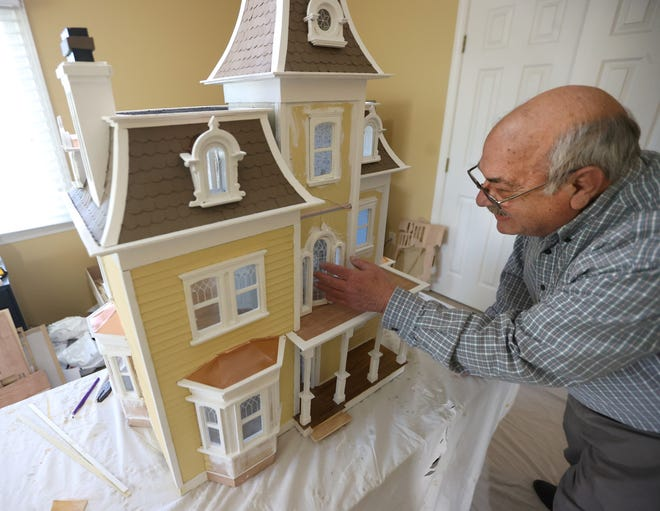 Joe Tomasello is building a 3-story Beacon Hill replica doll house for his 13-year old granddaughter Samantha O'Connell, similar to the one he built nearly 30 years ago for her mother Laurel. Tomasello is seen here next to his latest creation, inside the family's Collierville home on Tuesday, Dec. 22, 2020.