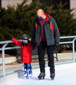 Derek Riley and son Donovan, 4, continue the tradition they started last year of skating at Red Arrow Park during the holidays. In Greenfield, the Dan Jansen Family Fest Ice Rink at Konkel Park opened briefly on Monday, Dec. 28, but had to close due to degrading ice conditions.