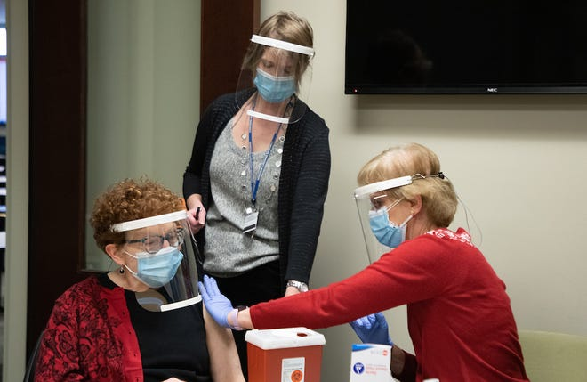 Liz Wagner, left, acts as a patient while Dr. Sarah Ray, center, instructs Donna Behlmer on how to administer a vaccination.