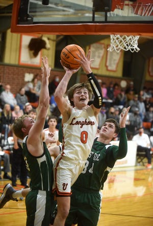 Viola's Blaine Marberry splits two West Side defenders during the Longhorns' 71-63 victory Monday night.