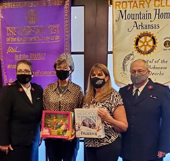 Pictured above are Salvation Army officer Michelle Robbins, Rotary President Renae Schocke, past Rotary President/SA Board member Kriss Yunker, and Salvation Army officer John Robbins.