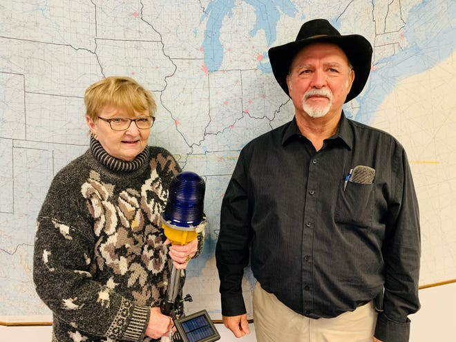 Baxter County Airport Manager Kathy Frederick, shown here with Baxter County Judge Mickey Pendergrass, will retire at the end of the year. Frederick has spent 12 years as the airport's manager.