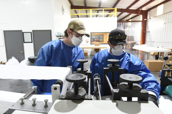 American95 employees Shane Free, left, and Steve Heckler closely monitor the mask manufacturing process at the Mountain Home plant. The founders of the company say part of the motivation for creating the company was to lessen American dependence on China for PPE.