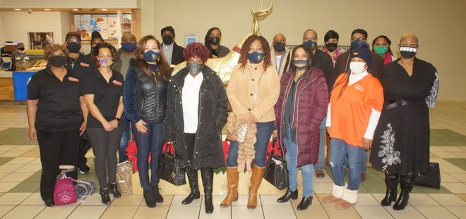 Four local African American organizations joined partnered to provide 20 families from local daycares with Christmas gifts this year.