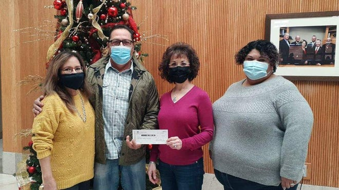 From left are 1st New Mexico Bank Associate Rosa Perez, Cancer Support board member Ray Trejo Jr. bank president Teresa Molina and Cancer Support Patient Advocate Joanna Costilla.