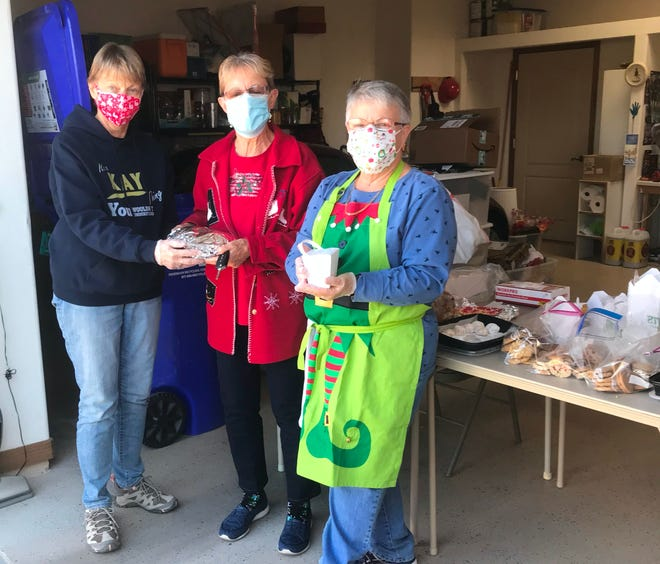 (From left:) Kay Williams, Rita Worrell and Kay Brilliant of the Las Cruces Chapter of the American Association of University Women hold cookies the organization prepared for hospital workers at MountainView Regional Medical Center.
