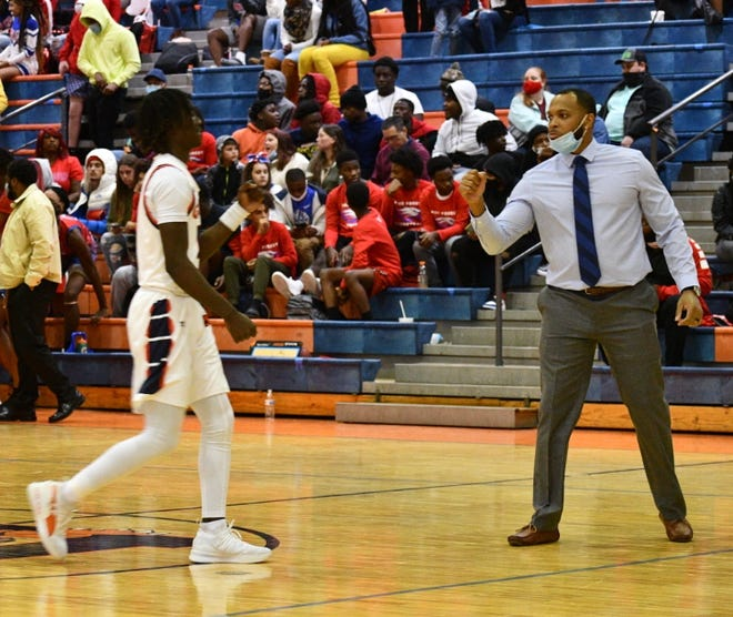 DJ Williams gears up for a home game against Pine Forest on Dec. 4 at Escambia High School.