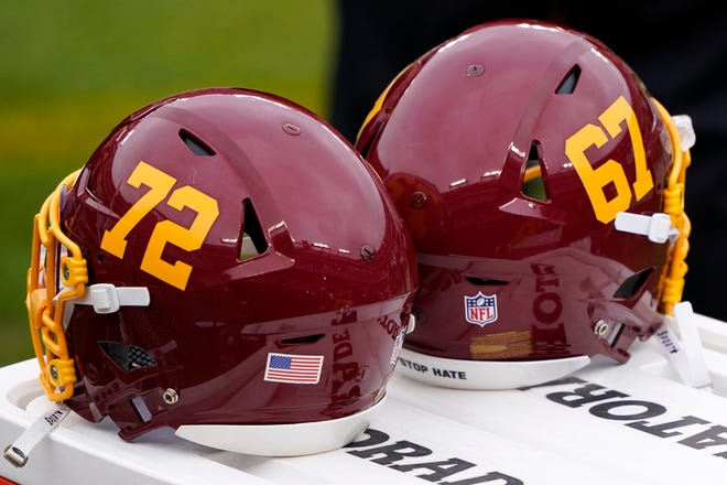 Washington Football Team helmets sit on the sideline prior to an NFL football game between the Seattle Seahawks and the Washington Football Team, Sunday, Dec. 20, 2020, in Landover, Md. (AP Photo/Mark Tenally)