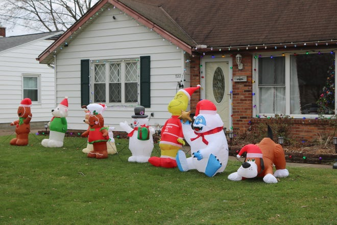 The Grinch, Frosty the Snowman and more Christmas-themed inflatable friends greet neighbors along Taft Street in Port Clinton as part of this home's seasonal display.