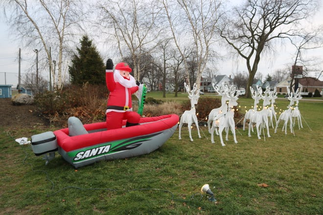 """Port Clinton Fire Chief Kent Johnson and resident James """"Snip"""" Snider teamed up to create this fishing-themed Christmas display fittingly placed at Erie Dearie Park along North Jefferson Street."""