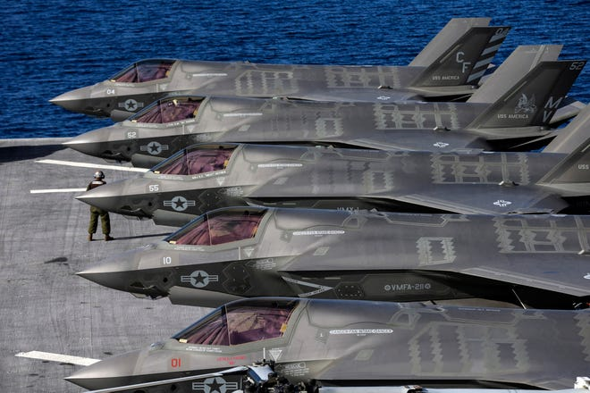 In this file photo, Lockheed Martin F-35B Lightning II supersonic aircraft are seen on the amphibious assault ship USS America (Irfan Khan/Los Angeles Times/TNS)