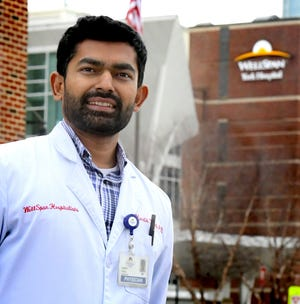 Frontline health worker Dr. Hardik Patel stands outside WellSpan York Hospital Tuesday, Dec. 22, 2020. He provides care to about 23 COVID-19 patients each day. Bill Kalina photo