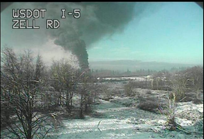 A Washington state Department of Transportation traffic camera captures an image of a train that derailed north of Seattle, close to the Canadian border on Tuesday, Dec. 22, 2020. Authorities say it was carrying crude oil.