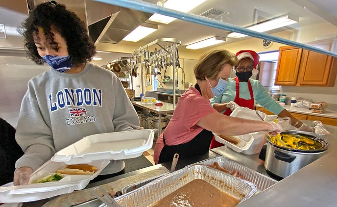 Volunteers prepare meals at the Wesley Trinity Daily Bread Soup Kitchen on Tuesday, Dec. 22, 2020.