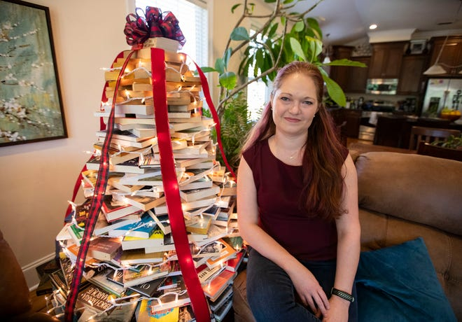 Sandi Poreda built a unique Christmas tree out of books instead of having a traditional tree this year.